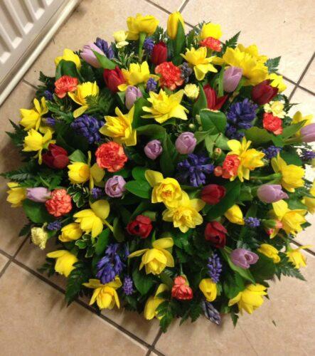 Spring Flower Closed Wreath - Brunels Funeral Directors